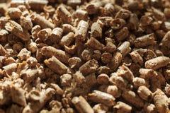 Close-up van de brandstof het houten korrel Een bron van alternatieve schone energie Heel wat korrel Natuurlijke brandstof en ene stock foto