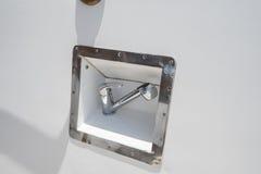 Close-up van een douchehoofd in schil van motorjacht Stock Foto's