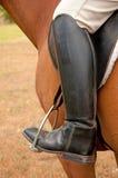 Close-up van een voet in een stijgbeugel Stock Afbeelding