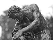 Close-up van figuurlijk bronsbeeldhouwwerk stock afbeeldingen