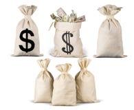 Close-up van Geld in zakken op wit wordt geïsoleerd dat stock foto