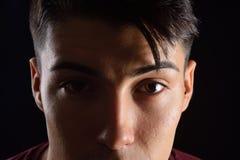 Close-up van gezicht van de jonge mens stock afbeelding