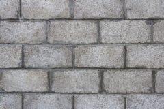 Close-up van grijze blokmuur stock afbeelding