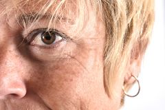 Close-up van het gezicht van een vrouw op middelbare leeftijd royalty-vrije stock afbeeldingen