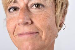 Close-up van het gezicht van een vrouw op middelbare leeftijd royalty-vrije stock fotografie