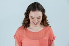 Close-up van het glimlachen Vrouw neer het kijken Stock Foto's