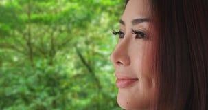 Close-up van het Japanse vrouw kijken vanaf camera royalty-vrije stock foto