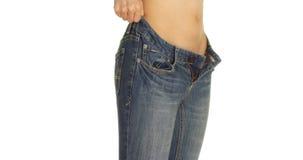 Close-up van het Chinese vrouw zetten op een paar jeans Royalty-vrije Stock Fotografie