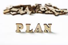 Close-up van inschrijvings het Plan geschreven houten brieven, het concept planning stock afbeelding