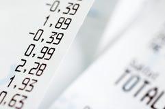 Close-up van kasregisterontvangstbewijzen Stock Fotografie