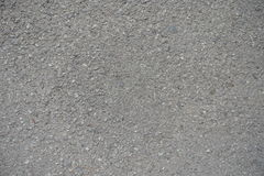 Close-up van korrelige oppervlakte van stoffig asfalt royalty-vrije stock fotografie