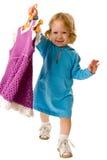 Close-up van mooie baby met nieuwe kleding op hanger Royalty-vrije Stock Afbeelding