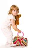 Close-up van mooie baby met stuk speelgoed en zak Stock Afbeelding