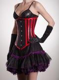 Close-up van mooie vrouw in zwart en rood korset wordt geschoten dat Royalty-vrije Stock Fotografie
