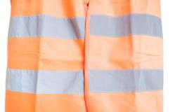 Close-up van oranje weerspiegelend vest als deel van eenvormige bescherming stock afbeeldingen