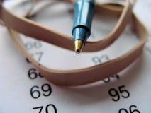 Close-up van pen en document Stock Afbeeldingen