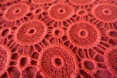 Close-up van rozeachtig oranje open borduurwerk Royalty-vrije Stock Foto's