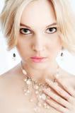Close-up van schoonheidsmeisje met het doordringen van ogen Royalty-vrije Stock Foto