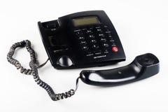 Close-up van weg de haak zwarte landline telefoon Royalty-vrije Stock Afbeelding