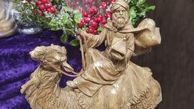 Close-up van wiseman op een decoratie van kameelkerstmis voor bloemenregeling royalty-vrije stock fotografie