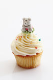 Close up of vanilla buttercream cupcake with panda figurine Royalty Free Stock Images