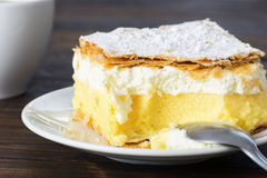 Close up of vanilla pudding cake. On wooden table Stock Photo
