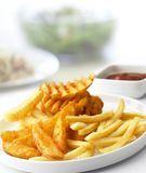 Variety potato fried on dish and tomato sauce on the table, salad and food background. Close up variety potato fried on dish and tomato sauce on the table royalty free stock images