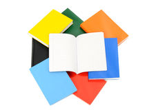 Close up on various books and a opened blank notebook. Stock Photo