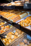 Close-up of various breads on display counter Royalty Free Stock Photos