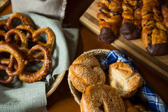 Close-up of various breads in a wicker basket on display counter Stock Photography