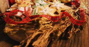 Close-up of various christmas desserts and gifts. On wooden table 4k stock video