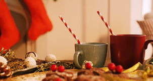 Close-up of various christmas desserts. And mug on wooden table 4k stock video footage