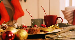 Close-up of various christmas desserts. And mug on wooden table 4k stock video