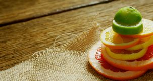 Various citrus slices stack on jute fabric 4K 4k. Close-up of various citrus slices stack on jute fabric 4K 4k stock footage