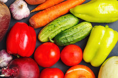 Close up of various colorful raw vegetables. healthy eating concept. Fresh raw vegetables - onions, garlic , green and red peppers , carrots , tomatoes , beets Stock Image