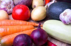 Close up of various colorful raw vegetables. Red onion, cauliflower, pepper, tomato and garlic Stock Photography