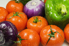 Close up of various colorful raw vegetables. Wet vegetables closeup on the full background horizontal Stock Image