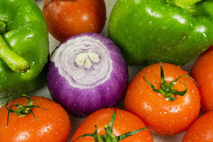 Close up of various colorful raw vegetables. Wet vegetables closeup on the full background horizontal Stock Photos