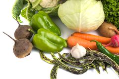 Close up of various colorful raw vegetables on white background Royalty Free Stock Photos