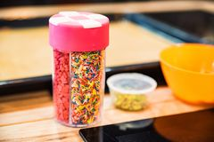 Colorful sugar sprinkling in jar. Close up various confectionery sprinkling in jar royalty free stock photography