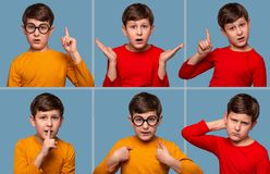 Close up various emotional portraits of boy wearing yellow abd red shorts on blue background in studio stock photo
