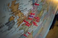 Close up of Europe pin pointed on the world map with a pink pushpin royalty free stock photography