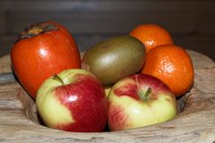 Close-up of various fruits in a wooden bowl. Torfhaus, Germany stock photos