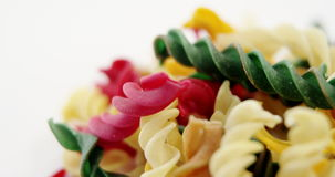 Close-up of various gemelli pasta. On white background stock video