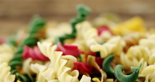 Close-up of various gemelli pasta. On wooden background stock video