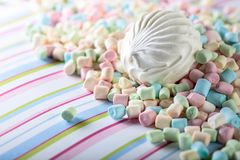 Close up of various marshmallows on a striped background. Stock Photography