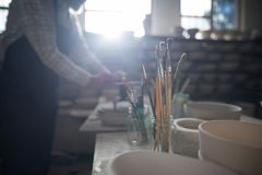 Close-up of various paint brush in pencil holder Royalty Free Stock Images