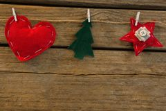Close up of various shapes Christmas decoration. Attached with rope on wooden table Royalty Free Stock Photos