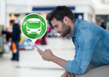 Man holding phone with bus icon Royalty Free Stock Photos