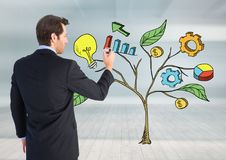 Man holding pen and Drawing of Business graphics on plant branches on wall Royalty Free Stock Image